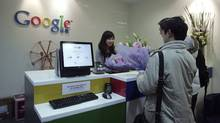 Chinese Google users presents flowers to the Google's Shanghai office in Shanghai