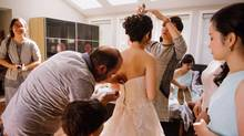 Jo Du is helped with her wedding dress in Cambridge, Ont., on Sept.25, 2016. (Lindsay Coulter/THE CANADIAN PRESS)