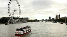 A pleasure cruise boat travels along the river Thames in front of the Houses of Parliament and the London Eye on October 22, 2010. (Oli Scarff/Getty Images/Oli Scarff/Getty Images)