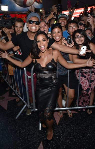 What fresh celebrity hell is this? Rosario Dawson willingly mingles among the unwashed throng of movie fans at the premiere of much-hyped sequel Sin City: A Dame to Kill For in Los Angeles. (John Shearer/Invision)