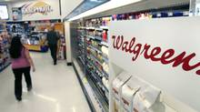 People pass the dairy section at a Salt Lake City Walgreens store in this file photo. (DOUGLAS C. PIZAC/DOUGLAS C. PIZAC/AP)