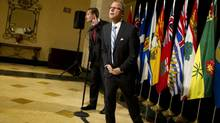 Saskatchewan Premier Brad Wall, right, and PEI Premier Robert Ghiz, left, strain to hear a question from a member of the media during an availability following their first session of meetings with provincial health ministers at The Royal York Hotel in Toronto on March 15, 2013. (Peter Power/Peter Power/The Globe and Mail)