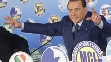 Media mogul and former Italian premier Silvio Berlusconi at a political rally in Rome on Wednesday. Many are impressed by his comeback from the political dead after his effective ouster in November, 2011. (Mauro Scrobogna/AP)