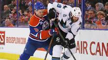Mar 8, 2016; Edmonton, Alberta, CAN; Edmonton Oilers defensemen Mark Fayne (5) and San Jose Sharks forward Joe Thornton (19) battle for a puck during the second period at Rexall Place. (Perry Nelson/USA Today Sports)
