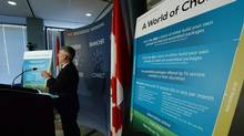 CTRC chairman Jean-Pierre Blais speaks to media at the CRTC offices in Gatineau, Que., on Thursday, March 19, 2015. (Sean Kilpatrick/THE CANADIAN PRESS)