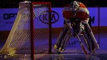 Philadelphia Flyers' Ray Emery skates past the net during introductions before an NHL hockey game against the New Jersey Devils, Thursday, Nov. 7, 2013, in Philadelphia. (Associated Press)