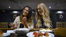 Jillian Lockwood, right, (with friend Mira Singh) turned her passion for food into a job. (Fred Lum/The Globe and Mail)