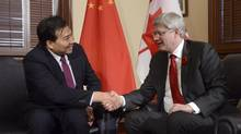 Canadian Prime Minister Stephen Harper meets with Ambassador of the People's Republic of China to Canada Luo Zhaohui in his office Friday October 31, 2014 in Ottawa. (Adrian Wyld/THE CANADIAN PRESS)