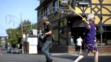 Terry Wilson, 64, walks across Fernwood and Gladstone St. towards the Corner Stone Cafe with his Big Bubbler used to create massive bubbles and entertain locals in Victoria. (Chad Hipolito/The Globe And Mail/Chad Hipolito/The Globe And Mail)