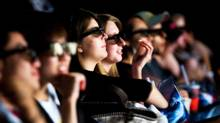 """Can't do this at home: Moviegoers watch """"Ice Age: Dawn of the Dinosaurs 3D"""" at Scotiabank Theatre in Toronto on July 2, 2009. (Jim Ross for the Globe and Mail)"""