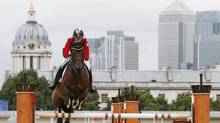 Canada's Tiffany Foster rides Victor during the equestrian individual jumping first qualifier in Greenwich Park at the London 2012 Olympic Games August 4, 2012. (MIKE HUTCHINGS/REUTERS)