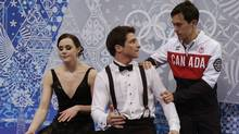 "Tessa Virtue and Scott Moir of Canada react with teammate Patrick Chan, right, in the ""kiss and cry"" area during the Team Ice Dance Short Dance at the Sochi 2014 Winter Olympics on Feb. 8. (Darron Cummings/Reuters)"