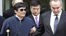 Activist Chen Guangcheng being accompanied by U.S. Assistant Secretary of State for East Asian and Pacific Affairs Kurt Campbell (front R) and U.S. Ambassador to China Gary Locke (C), in Beijing, May 2, 2012. (HANDOUT/REUTERS)