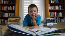 Teachers are finding ways to ensure their students, like Oscar Judelson-Kelly, hone critical thinking and curiosity skills that don't require WiFi., and perhaps consider the possibility that Google isn't omnipotent. Oscar Judelson-Kelly, 11, is photographed in his family's Waterloo home with an array of books; many of which he used to complete a recent Grade 7 assignment of 100 questions that had to be answered computer-free. (Peter Power/The Globe and Mail)