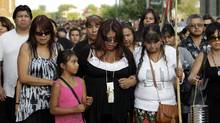 The family of Tina Fontaine leave a vigil on Wednesday near the Alexander Docks along the Red River in Winnipeg, from which Tina's body was recovered on Sunday. (LYLE STAFFORD For The Globe and Mail)