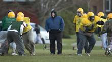 Toronto mayor Rob Ford coaches the Don Bosco Eagles ahead of their 2012 Metro Bowl appearance. (Peter Power/The Globe and Mail)