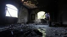 A Libyan man investigates the inside of the U.S. Consulate on Sept. 13, 2012, after an attack that killed four Americans, including Ambassador Chris Stevens on the night of Sept. 11, 2012, in Benghazi, Libya. (Mohammad Hannon/AP)