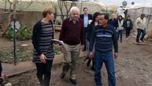 Minister of Immigration, Refugees and Citizenship John McCallum, centre, visits a Syrian refugee camp in the southern town of Ghaziyeh on Dec. 18. (Bilal Hussein/AP Photo)