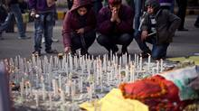 An Indian family lights candles in memory of a gang-rape victim in New Delhi, India, Saturday, Jan. 5, 2013. (Altaf Qadri/AP)