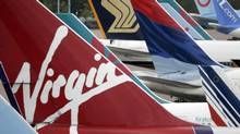 Delta Air Lines Inc. is nearing an agreement to buy Singapore International Airlines' 49-per-cent stake in Virgin Atlantic Airways, and is expected to agree to a transatlantic joint venture with Virgin Atlantic Airways, a source said. (PHIL NOBLE/REUTERS)