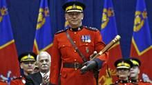 New Royal Canadian Mounted Police Commissioner Bob Paulson holds the Tipstaff during a change of command ceremony in Ottawa Dec. 8, 2011. (CHRIS WATTIE/CHRIS WATTIE/REUTERS)