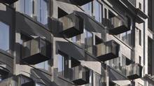 Mirror-polished aluminum balconies at the Avenue on Portage aptly reflect a new architectural energy. (James Brittain)