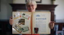 Jeannette Vander Kooy displays some of her Moscow memorabilia in a scrapbook at her home in Oak Bay, B.C. (Chad Hipolito/The Globe and Mail)