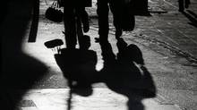 The shadows of shoppers are cast onto the ground in St Helier, Jersey November 13, 2012. Jersey, the British offshore tax haven, has since the 1960s developed a formidable offshore banking and finance sector . Picture taken November 13, 2012. (Stefan Wermuth/REUTERS)