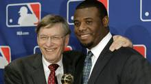 Ken Griffey, Jr, right, poses with Baseball Commissioner Bud Selig after Griffey received the Commissioner's Historic Achievement Award before Game 4 of baseball's World Series between the St. Louis Cardinals and the Texas Rangers Sunday, Oct. 23, 2011, in Arlington, Texas. (AP Photo/Darron Cummings) (Darron Cummings/AP)