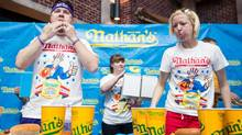American Aaron Osthoff, left, and Canadian Meredith Boxberger square off at the 2nd annual Nathan's Canadian Hot Dog Eating Championship near Calgary Saturday. (Chris Bolin/The Globe and Mail)