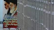 A poster of Iran's Supreme Leader Ayatollah Ali Khamenei and the late Ayatollah Ruhollah Khomeini is seen next to bank of centrifuges in what is described by Iranian state television as a facility in Natanz, in this still image taken from video released February 15, 2012. (REUTERS TV/REUTERS)