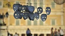 Masks hung by protesters hang at the occupied central Athens Syntagma square, opposite of the Greek Parliament on July 11, 2011. (LOUISA GOULIAMAKI/AFP/Getty Images/LOUISA GOULIAMAKI/AFP/Getty Images)