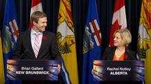 Alberta Premier Rachel Notley and New Brunswick Premier Brian Gallant promoting the TransCanada Corp. project as a job-creation venture that's environmentally sustainable in Edmonton. (Jason Franson/The Canadian Press)