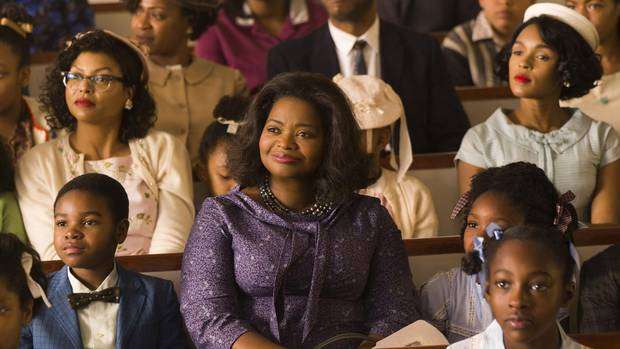 Taraji P. Henson, background left, Octavia Spencer, center, and Janelle Monae, background right, in Hidden Figures.