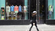 A pedestrian walks past the Lululemon Athletica store Tuesday, March 19, 2013 at Union Square in New York. (Mary Altaffer/AP)