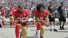 San Francisco 49ers quarterback Colin Kaepernick didn't start this with his anthem protest, but he leads by example. (Mike McCarn/AP)