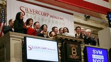 Employees and guests of Silvercorp Metals attend the opening bell at the New York Stock Exchange, Monday, March 8, 2010. (Mark Lennihan/The Associated Press)