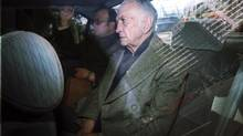 Jose Alfredo Martinez de Hoz is seen inside a vehicle after leaving a court in Buenos Aires in this July 10, 2003 file photo. Martinez de Hoz, aged 87 and former economy minister during the country's 1976-1983 dictatorship, died on March 16, 2013, according to the local media. (Enrique Garcia Medina/REUTERS)