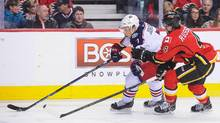 Kris Russell (4) of the Calgary Flames chases Jack Johnson (7) of the Columbus Blue Jackets during an NHL game at Scotiabank Saddledome on February 5, 2016 in Calgary, Alberta, Canada. (Derek Leung/Getty Images)