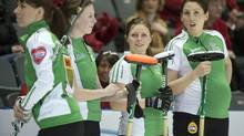 Team Saskatchewan's Kara Johnston, right, who is seven months pregnant, chats with teammates Jill Shumay, left, Jinaye Ayrey, second left, and Taryn Holtby during curling action against the Northwest Territories at the Scotties Tournament of Hearts in Kingston, Ont., on Saturday, February 16, 2013. (Ryan Remiorz/THE CANADIAN PRESS)