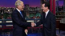 """This May 4, 2011 image from video released by CBS shows host David Letterman, left, shaking hands with fellow talk show host Stephen Colbert of """"The Colbert Report,"""" during a surprise visit on the """"Late Show with David Letterman,"""" in New York. CBS on Thursday, April 10, 2014, announced that Colbert, the host of """"The Colbert Report,"""" will succeed David Letterman as the host of """"The Late Show."""" ( (CBS, Worldwide Pants Inc./AP)"""