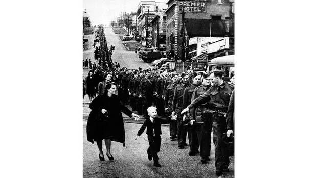 """The photo """"Wait for me, Daddy"""" shows Private Jack Bernard saying goodbye to his five-year-old son Warren as he leaves for the Second World War in New Westminster, B.C., on Oct. 1, 1940. (Claude P. Dettloff/The Canadian Press/The National Archives of Canada)"""