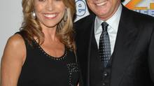 """Vanna White, co-host of """"Wheel of Fortune"""", arrives with host Pat Sajak at Radio City Music Hall to celebrate the 25th anniversary of the game show in New York, Thursday Sept. 27, 2007 (Peter Kramer/AP)"""
