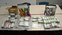Cash and drugs seized in a two-province marijuana bust in B.C. and Ontario (Ontario's Asian Organized Crime Task Force/Handout)