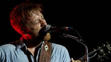 Dan Auerbach from The Black Keys performs at Lollapalooza in Chicago's Grant Park on Friday, Aug. 3, 2012. (Sitthixay Ditthavong/Invision/AP)