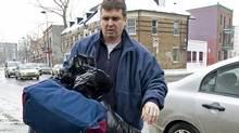 Former chief executive of the Norbourg investment company and convicted fraudster Vincent Lacroix arrives at a half-way house in Montreal on Jan. 27, 2011, after being released from prison. (Graham Hughes/THE CANADIAN PRESS)