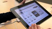A salesperson shows iPad pricing to a customer at an Apple store in Vancouver, B.C., on Friday May 28, 2010. Apple Inc. launched the iPad in Canada and eight other countries on Friday. THE CANADIAN PRESS/Darryl Dyck