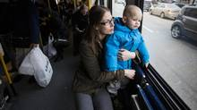 Amanda McKay rides the bus with her son Nolan Bentley, 2, after picking him up from daycare in Vancouver on Feb. 16. (Ben Nelms for The Globe and Mail)
