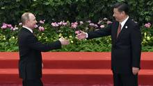 Chinese President Xi Jinping, centre, shakes hands with Russian President Vladimir Putin during a welcome ceremony for leaders attending the Belt and Road Forum, at the Great Hall of the People in Beijing, Sunday, May 14, 2017. (Wang Zhao/Pool Photo via The Associated Press)