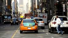 Morning traffic on Yonge St. near King St. in downtown Toronto. (2012 file photo). (Fred Lum/The Globe and Mail)